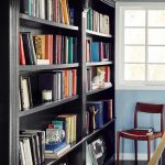 A black bookshelf is a great trick to make colorful books pop. In this home libr...