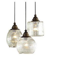 Allen + roth Cardington Aged Bronze Multi-Light Craftsman Clear Glass Dome Pendant Light at Lowes.com