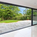 Aluminium sliding doors opening onto patio.