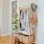An Easy Storage Solution for a Small Closet. Bamboo clothing rack in bedroom for...