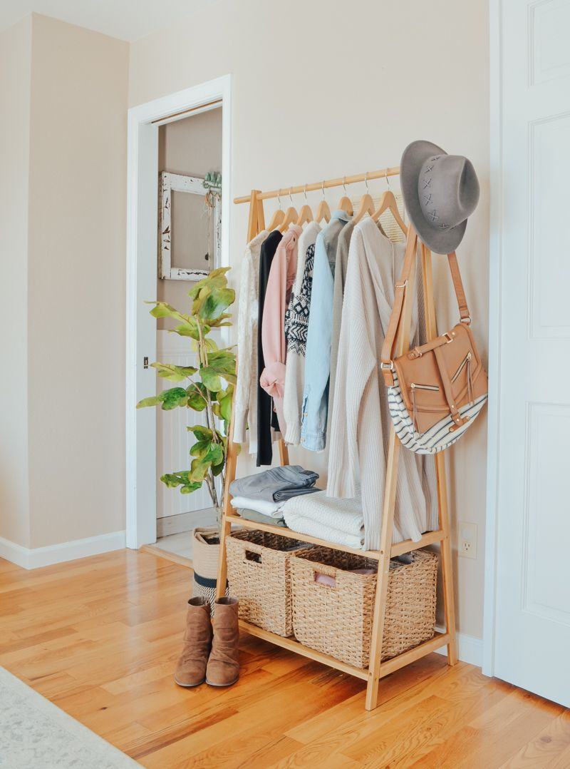 An Easy Storage Solution for a Small Closet. Bamboo clothing rack in bedroom for…