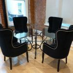 Awesome black wing back dining chair with round glass dining table | Home Interi...