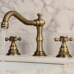 Bathroom Sink Faucet - Widespread Antique Copper Widespread Two Handles Three Ho...