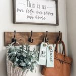 Easy entry way decorating ideas using a storage bench, hooks and decor! | Wilshire Collections