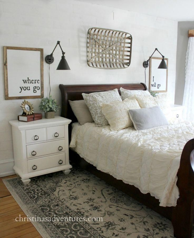 Farmhouse bedroom makeover – white planked wall, dark sleigh bed, patterned rug,…