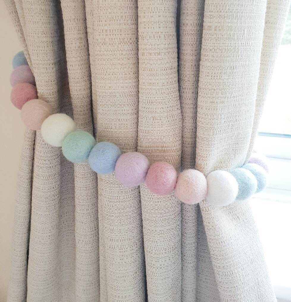 Feltball curtain Tie backs . Pastel rainbow pom pom tiebacks for home or girls & boys nursery decor . Handmade  hold backs