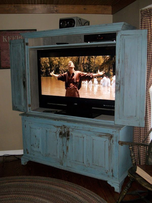 Flat screen tv armoire with pocket doors   for your home