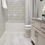 Flooring: Tile, Anatolia, Eramosa, 12x24, Ice; Shower: Tile, Anatolia, Soho Gloss, 4x16, Whit...