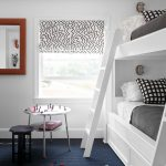 Fun black and white textile for the roman shade + navy blue carpet and white bui...