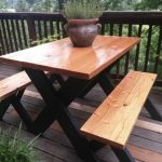 Here's a really classy at a picnic table. Finished wood on top and black painted...