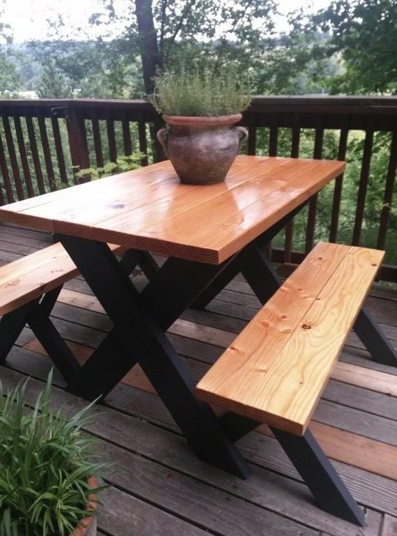 Here's a really classy at a picnic table. Finished wood on top and black painted…