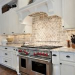 Kitchen Brick Backsplash. Kitchen with granite countertop and brick backsplash. ...