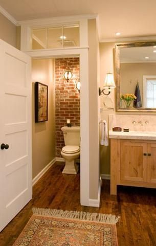 Love the brick in the commode area…………little touches like this make all …