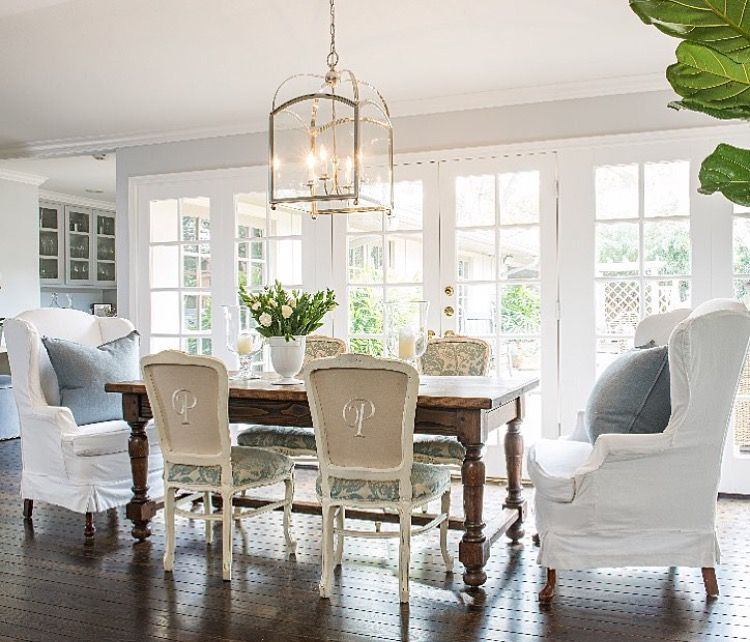 Love the wingback chairs at the head of the table and the back upholstery detail…