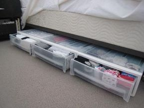 Pricey ($25) but awesome (and stackable!) underbed drawers. Just over 6″ tall.