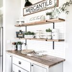 Sharing our dining room buffet area with you.  We installed subway tile with DIY...