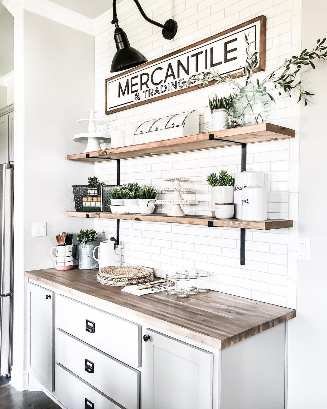 Sharing our dining room buffet area with you.  We installed subway tile with DIY…