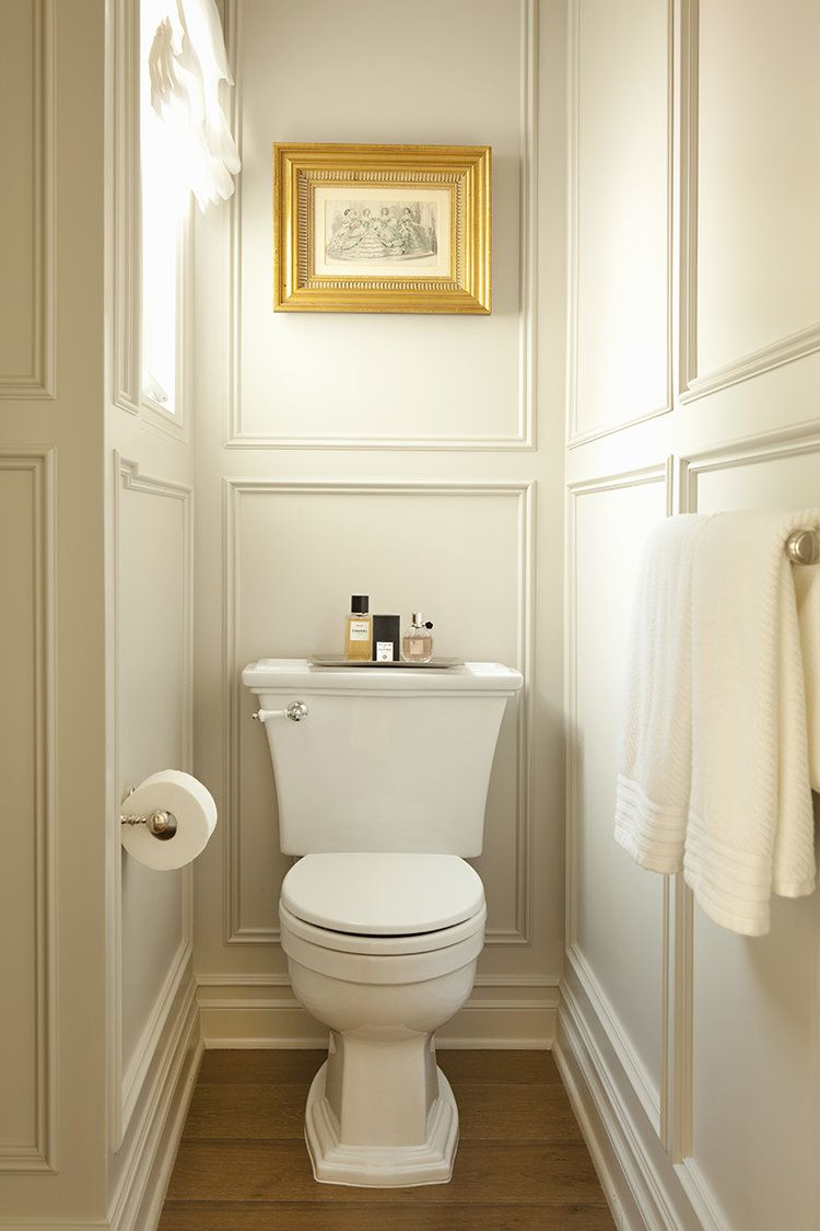 The wainscoting makes a difference in this small bathroom.  I like it.