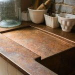 We went for one of our hand-aged copper worktops for the Sebastian Cox Potting S...