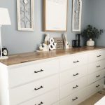 a large sideboard made of several Malm dressers with black handles and a single ...