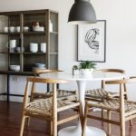 dining room, white small round dining table, wooden chair with rattan cushion, w...