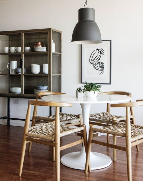 dining room, white small round dining table, wooden chair with rattan cushion, w…
