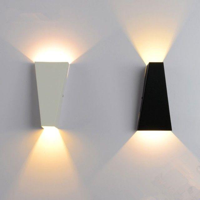 Modern iron wall lamp, minimalist geometric aesthetic concept .