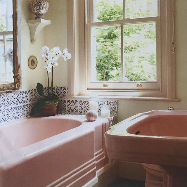 Pink bathroom suite with blue & white tiles from @houseandgardenuk .