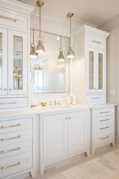 Bathroom vanity cabinets with Antiqued Mirrored Doors .