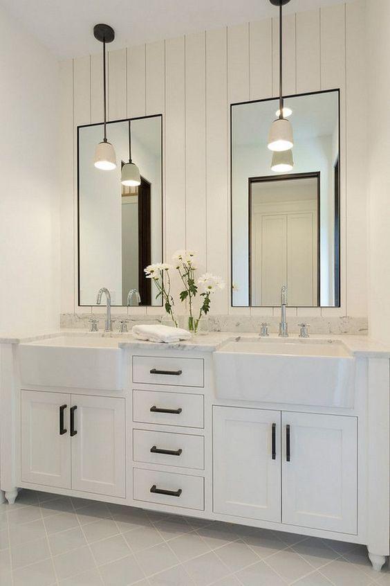 Bathroom shiplap wall behind mirrors. Bathroom with shiplap wall .