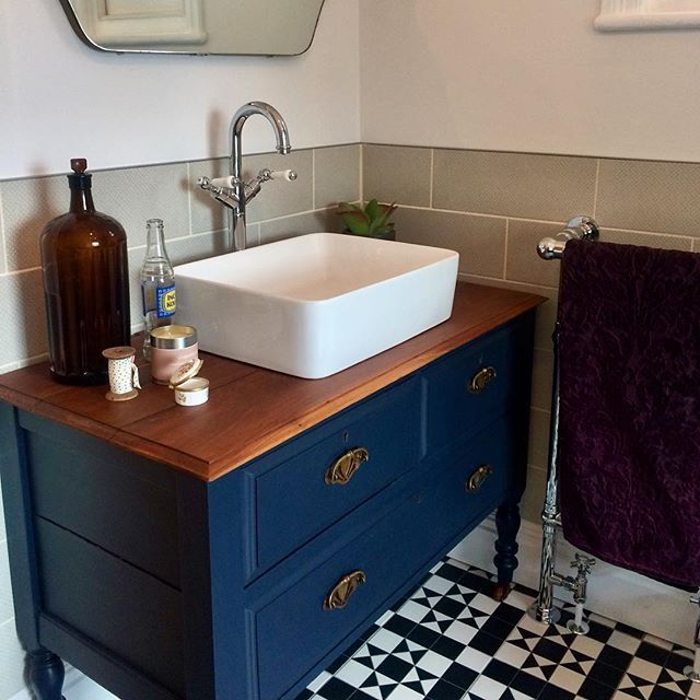Bathroom vanity unit, monochrome floor tiles, blue vanity unit .