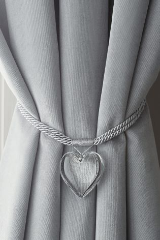 Who knew a tie back could be so gorgeous? This heart shaped one is .