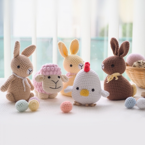 Easter decoration: bunnies, chick, sheeps and eggs amigurumi .