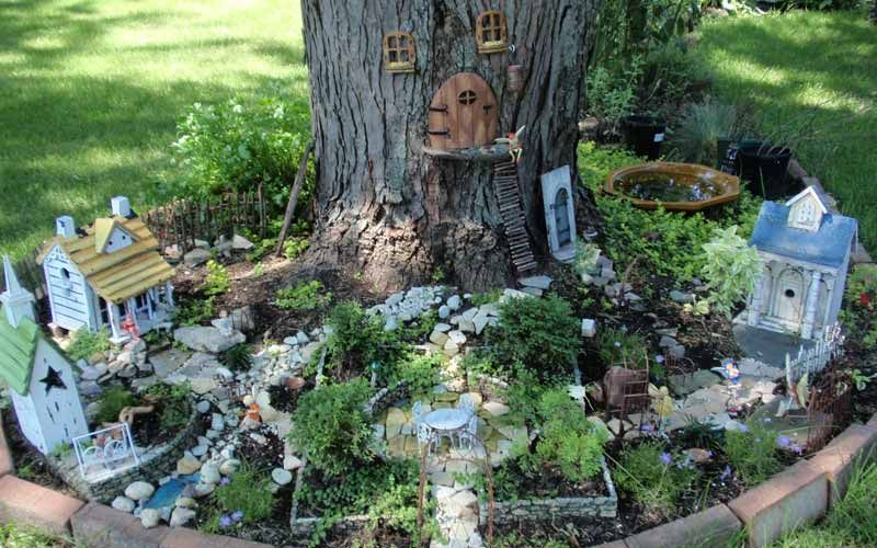 Fairy garden at the base of a tree....such fun! I can't wait to .