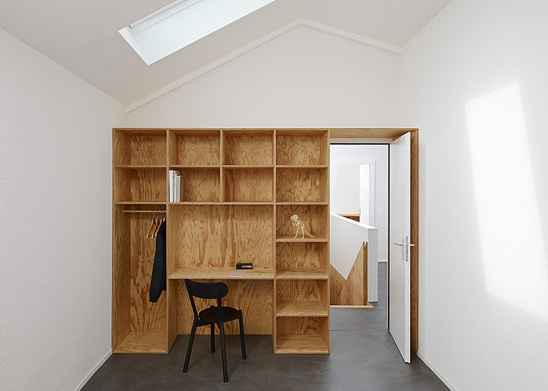 Eclépens apartment interiors with boxy wooden furniture by Big-Ga