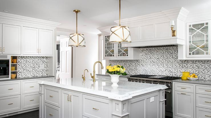 White and Gold Drum Pendant Lights Over Light Gray Island .