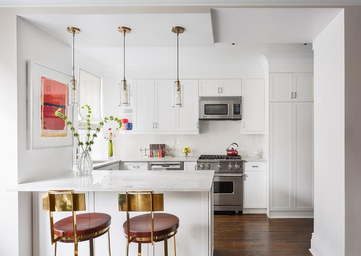 Small White Kitchen with Mini Brass and Glass Pendant Lights .