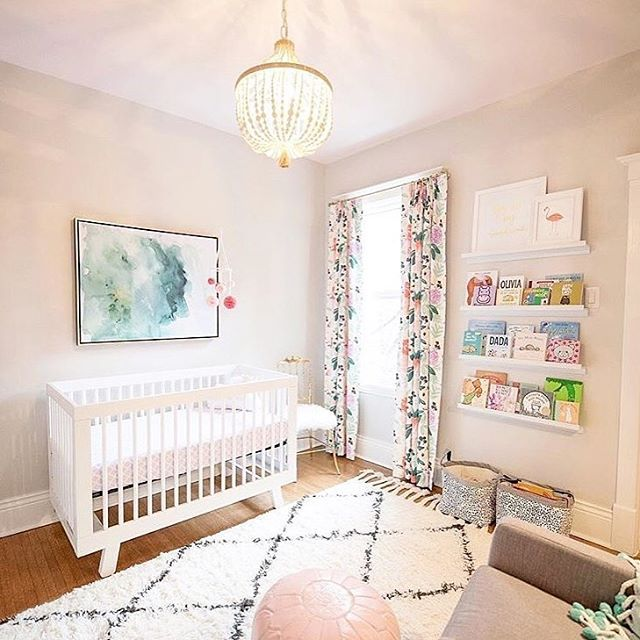 Stunning baby girl nursery - those floral drapes are perfection .