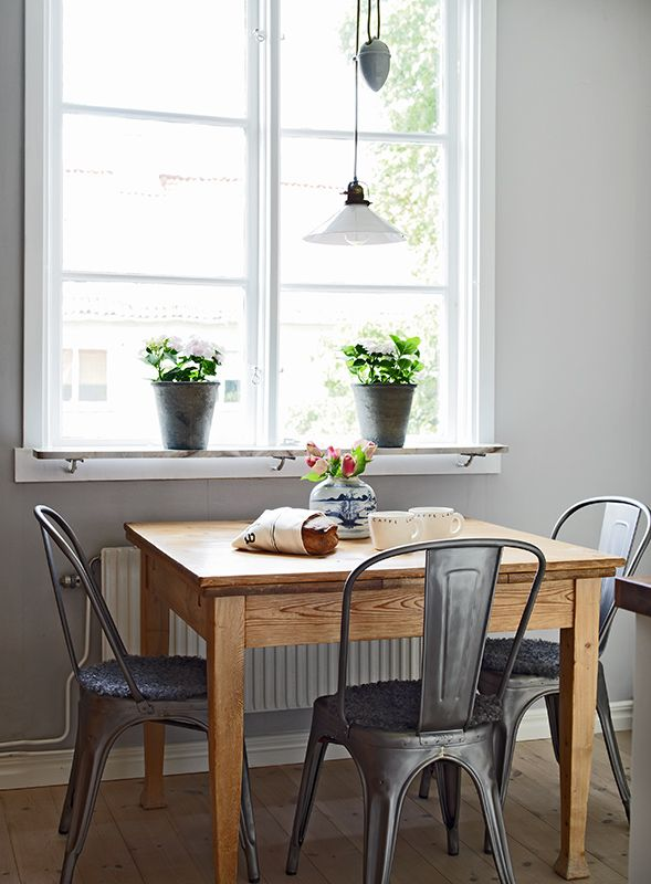 Square Wooden Dining Table // Metal Cafe Chairs // Indoor Plants .