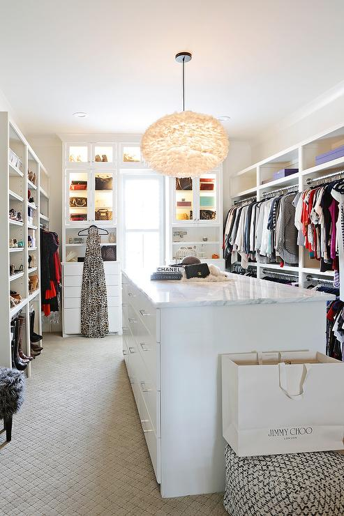 White Walk in Closet with White Feather Chandelier - Transitional .